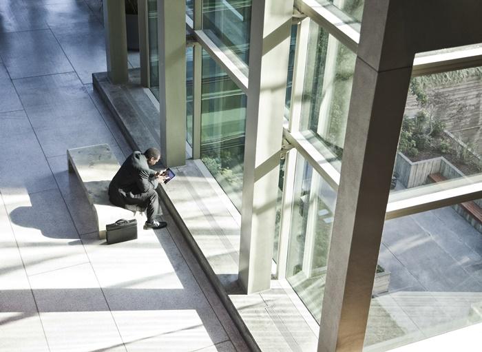black business man on a notebook computer sitting KURVP