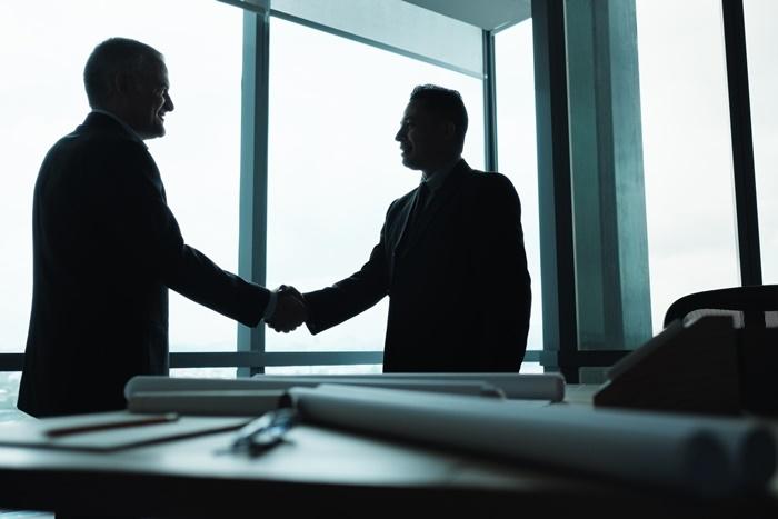 manager shaking hands of business partner in meeti TSJDMP